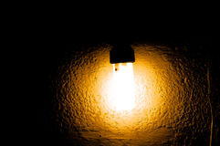 Gold color lamplight. Gold colorful lamp light in night with wall on background Stock Images