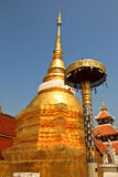Gold color pagoda in Wat Pong Sanook at Lampang Thailand Royalty Free Stock Photo