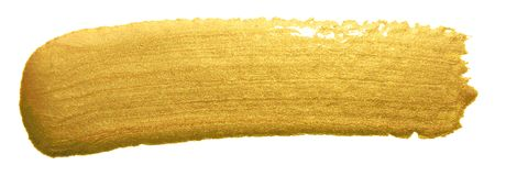 Gold color paint brush banner. Acrylic golden smear stroke stain on white background. Shine abstract detailed gold glittering text. Ured wet paint stroke for Stock Photography
