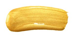 Gold color paint brush stroke. Acrylic golden smear stain on whi Stock Images