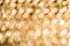 Gold color shiny ornaments bokeh Royalty Free Stock Image