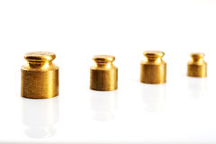 Gold color weight on a white background Stock Photos