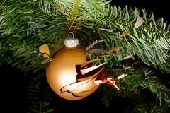 Bauble on a Christmas tree exploding Royalty Free Stock Image