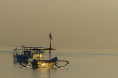 Gold-colored boats at sunrise. In bali royalty free stock images