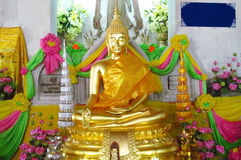 Gold-colored Buddha and monks statue in Buddhist temple Royalty Free Stock Photography