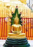 Gold-colored Buddha statue in Buddhist temple Stock Image