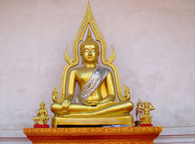 Gold-colored Buddha statue in Buddhist temple royalty free stock image