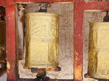 Gold colored Buddhist prayer wheel in Lhasa, Tibet Royalty Free Stock Images