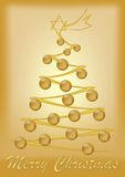Gold colored Christmas card with tree royalty free stock images