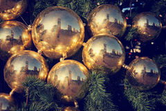 Gold colored Christmas decorations on green fir tree in Moscow, Royalty Free Stock Photos