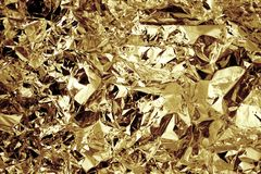 Gold colored crushed foil textured background. Gold colored crushed foil effect and textured background Stock Photography