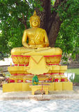 Gold-colored lying Buddha statue in Buddhist temple Stock Photos
