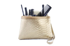 Gold colored makeup bag with make-up Royalty Free Stock Image