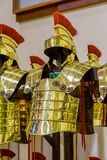 Gold-colored Roman armor in the city Gerona of Spain, 13 May  2017 Royalty Free Stock Photos