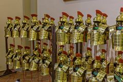 Gold-colored Roman armor in the city Gerona of Spain, 13 May  2017 Stock Image