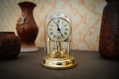 Gold-colored shelf clock Royalty Free Stock Photo