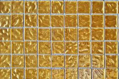Gold colored square tile mosaic Stock Photo