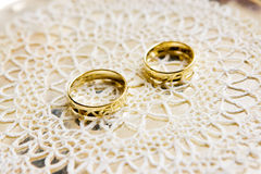 Gold-colored wedding rings Stock Images