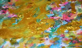 Gold colorful sparkling waxy vivid pastel spots watercolor blurred waxy gold spots colorful hues, strokes of brush, backgrounnd. Colorful sparkling waxy pastel Royalty Free Stock Image