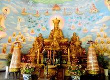 Gold colour Buddha statue and paintings royalty free stock images