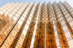Gold colour office building tower facade  in business center Stock Photo