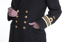 Gold coloured buttons and braid on a uniform. Lt Commander a female naval officer in uniform Stock Photos