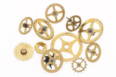 Gold-coloured cogwheels. Many old gold-coloured little cogwheels are connected royalty free stock photography
