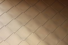 Gold-coloured metal scales on modern building #3 Stock Photography