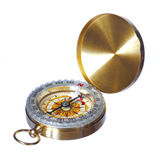 Gold compass isolated on white stock images