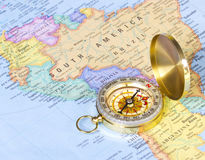 Gold compass on map of Africa stock image