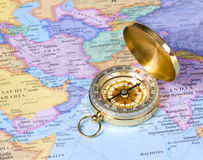 Gold compass on map of Asia stock photography