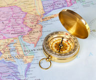 Gold compass on map of United States Royalty Free Stock Image