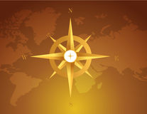 Gold compass over a world map brown Royalty Free Stock Images