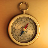 Gold compass on paper Royalty Free Stock Images