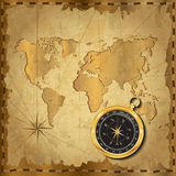 Gold compass on vintage map. Gold compass with wind-rose on vintage map. Adventure stories background Stock Photography