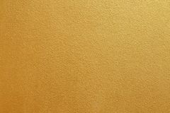 Gold concrete wall on background texture. stock photography