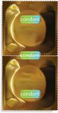 Gold condom packet. Stock Photo