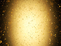Gold Confetti. Illuminated background with gold confetti falling with depth of field royalty free stock image