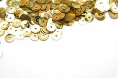 Gold confettis. On the isolated background Royalty Free Stock Photography