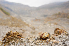 Gold and copper mining. Gold and copper quarry. Mining waste. Poisoned industrial landscape. Rock detail Stock Photos
