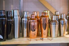 Gold and copper shakers, glasses and cookware for cocktails are at the bar stock photography