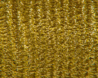 Gold Cord. Metallic gold gift wrapping cord on a spool, background or texture stock photography