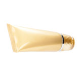 Gold cosmetic tube with transparent cap Stock Image