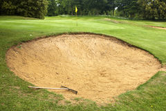 Golf course bunker with rake Royalty Free Stock Photo