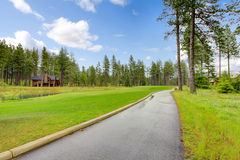Gold course trail with pine trees and homes. Royalty Free Stock Photos
