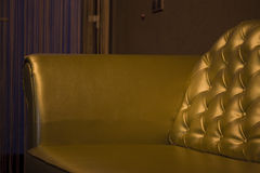 Gold coutch. Gold decoration spa wellness seating on coutch leather yellow relax Stock Photography