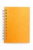 Gold cover note book. On white background Stock Image