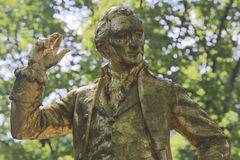 A gold-covered statue ofThomas Paine is found in the Parc Montsourisalong the Boulevard Jourdan inthe 14th arr.; the inscriptio Royalty Free Stock Photo