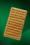 Gold cracker on green Stock Photo