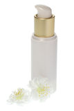Gold and cream cosmetics dispenser bottle Royalty Free Stock Images